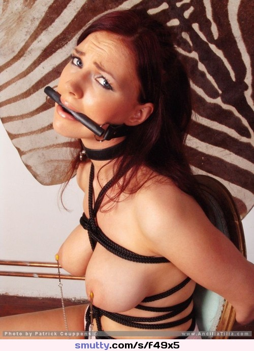 lustful blonde bitch in vintage stockings and a suspende